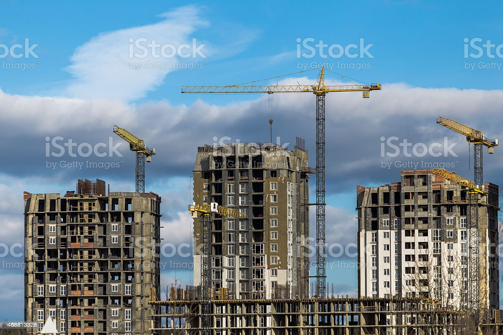 Construction of high-rise buildings with cranes stock photo