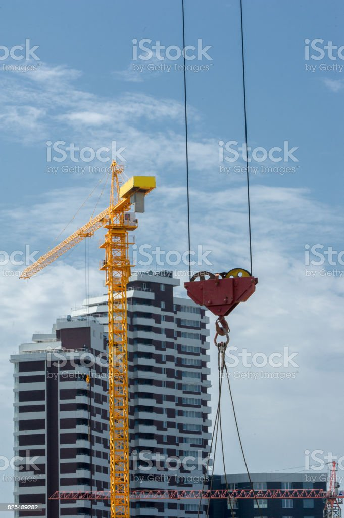 Construction of houses. Tower cranes stock photo