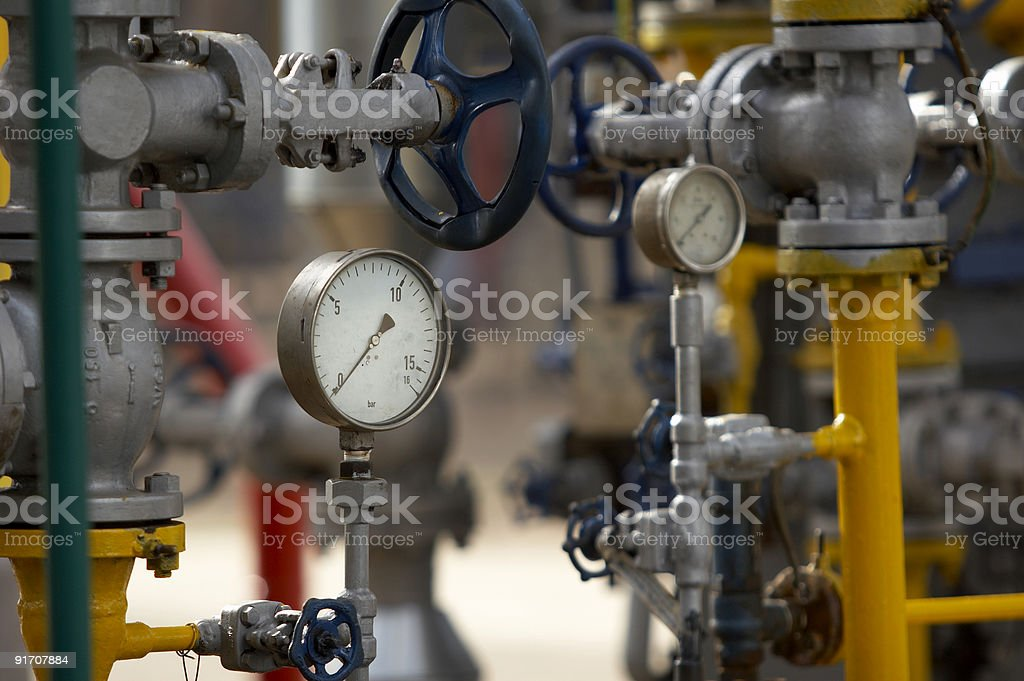 A construction of metal pipes and pressure indicators royalty-free stock photo