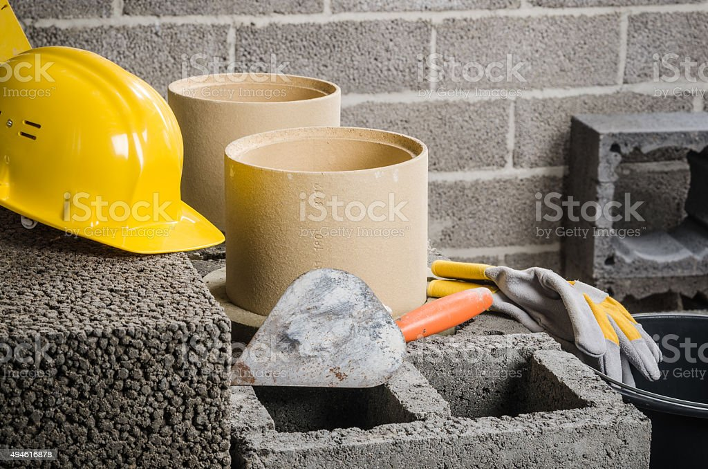 Construction of modular ceramic chimney in the house stock photo