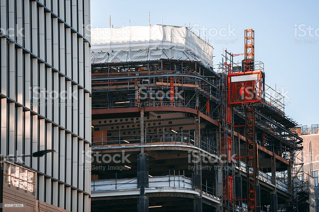Construction of new building. Scissor lift going up stock photo