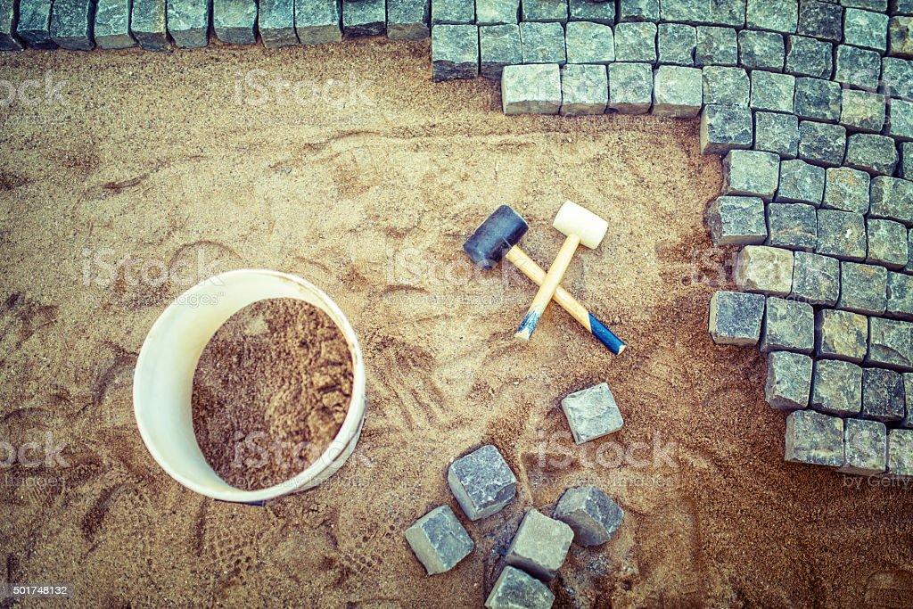 Construction of pavement details, cobblestone pavement, stone blocks stock photo