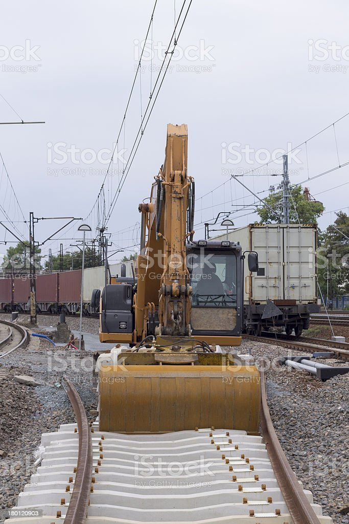 Construction of railway tracks using excavators royalty-free stock photo