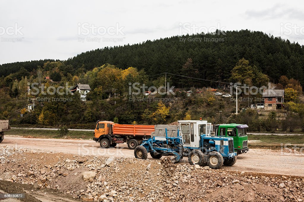 Construction of road, working machines. stock photo