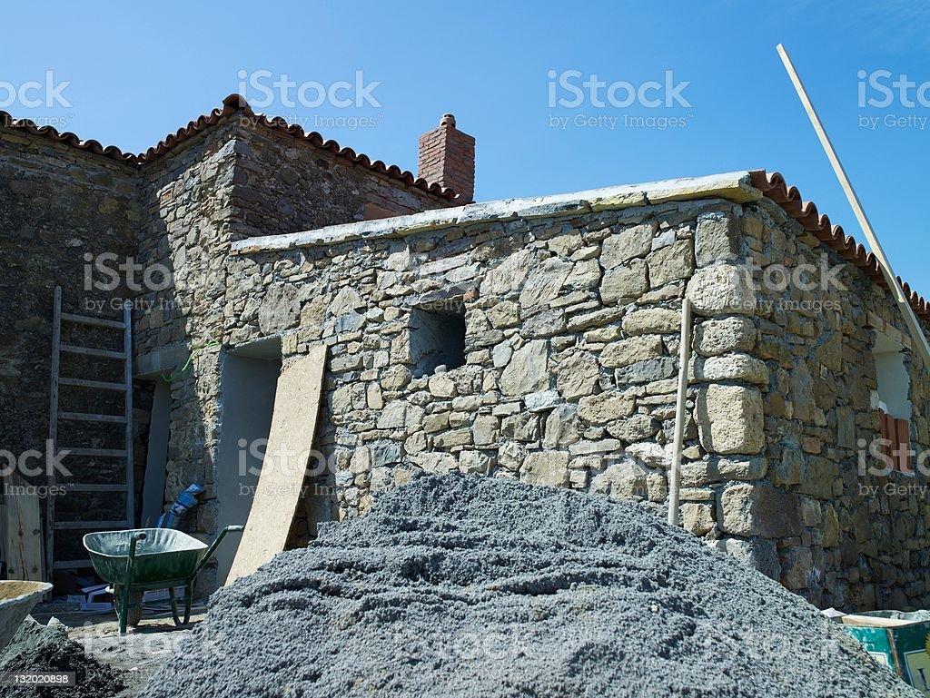 Construction of stone houses stock photo