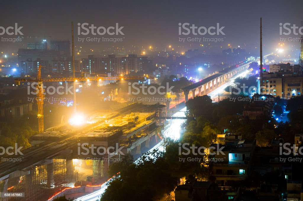 Construction of the delhi metro at night stock photo