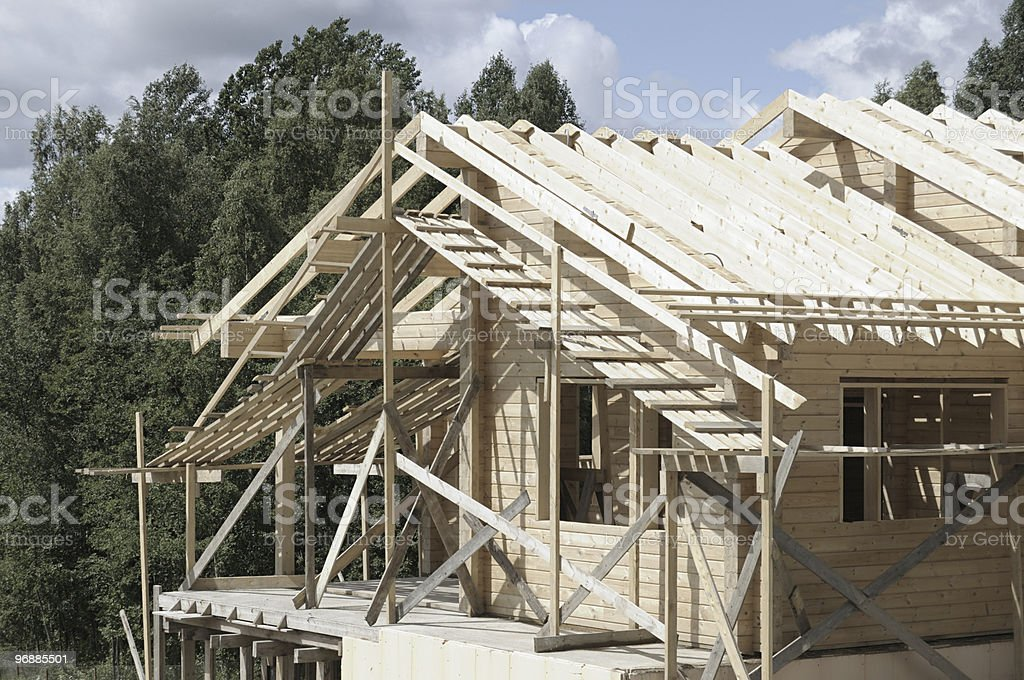 Construction of the wooden house stock photo