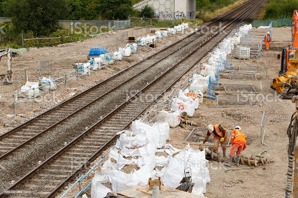 Construction on site next to a section of railway track stock photo
