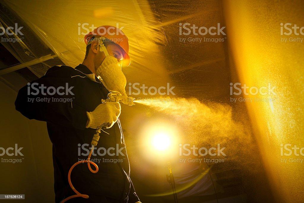 Construction painter with spray gun stock photo
