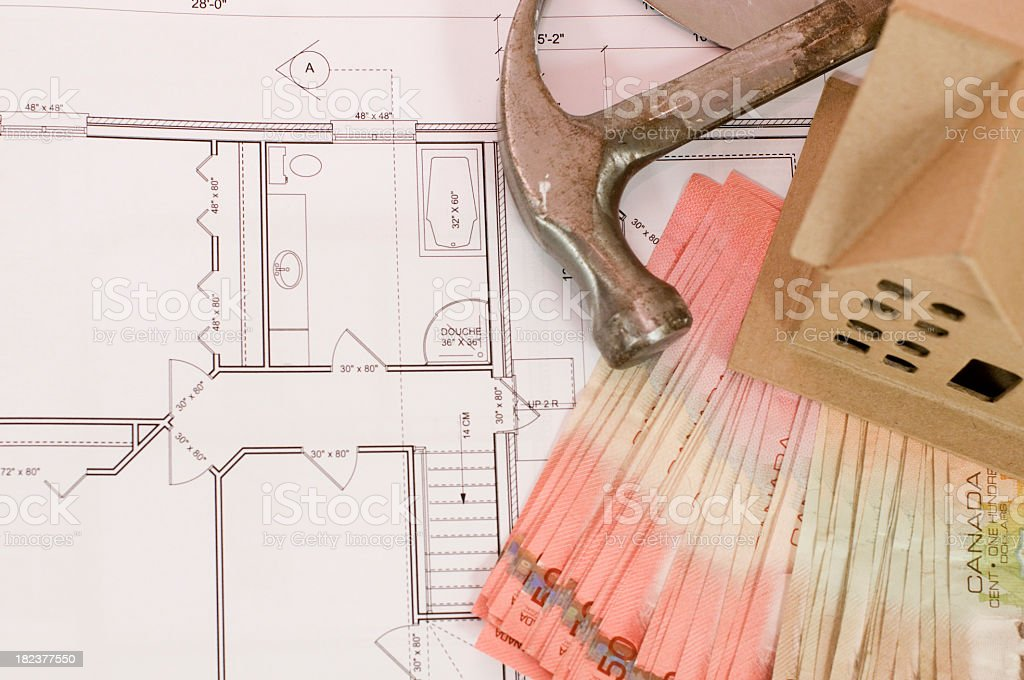 construction plan with money and tools royalty-free stock photo