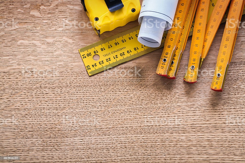 Construction plans and instruments of measurement on oaken woode stock photo