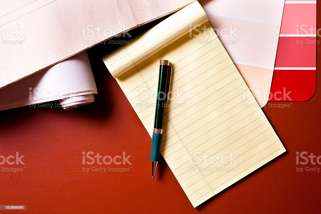Construction plans, color swatches, notepad and pen royalty-free stock photo