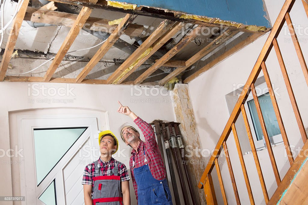 construction reconstructtion old house worker damage stock photo