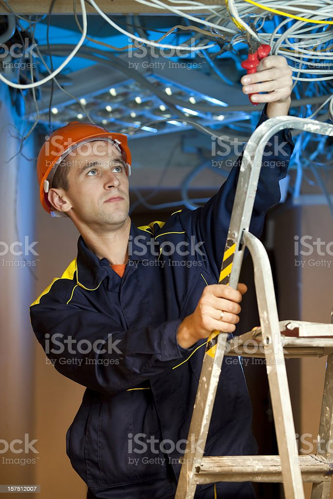 Construction repairman on stepladder stock photo
