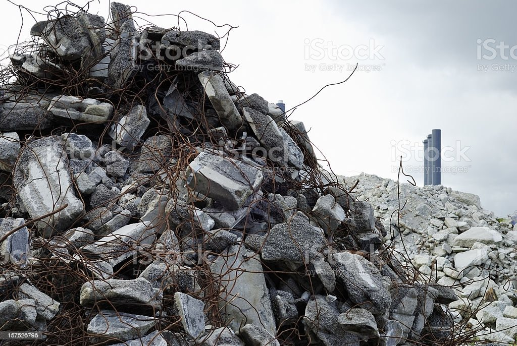 construction scrap, chimneys in the background royalty-free stock photo