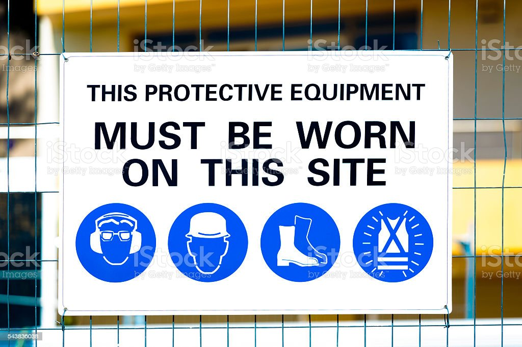 Construction sign DANGER attached on wire fence stock photo