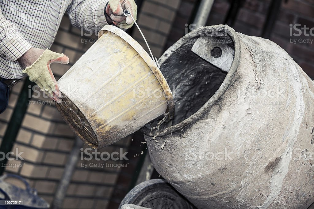 Construction site:  Adding water to cement stock photo