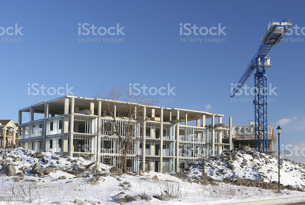Construction site and Crane in Winter royalty-free stock photo