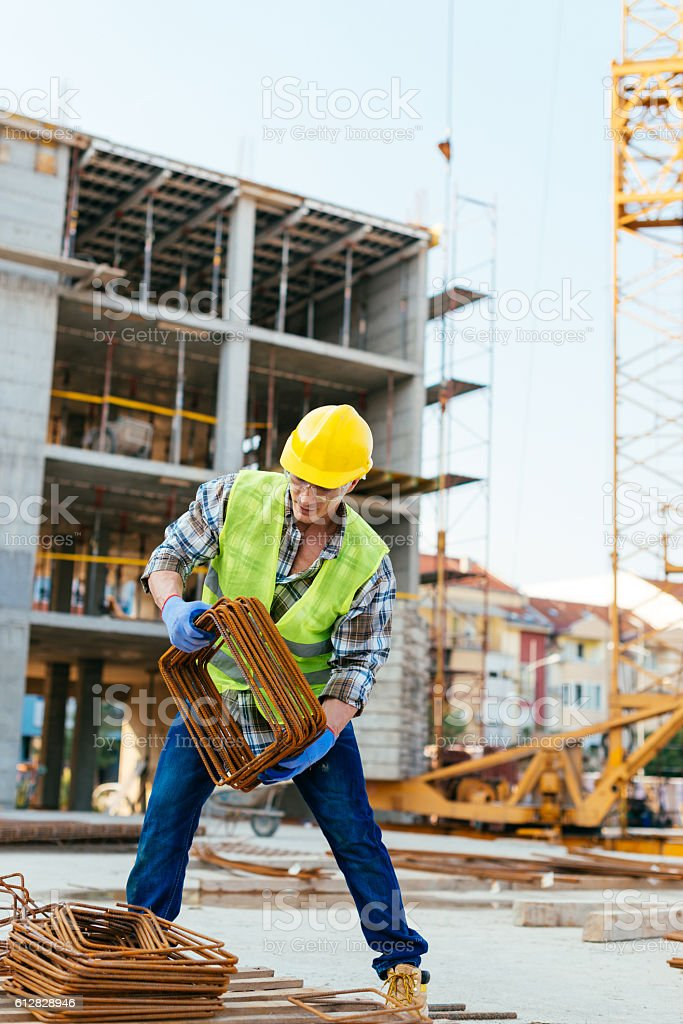Construction site and workers on the move stock photo