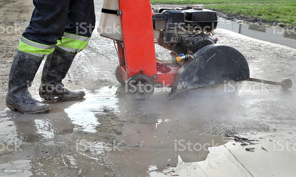 Construction site, asphalt cutting tool at road construction site stock photo