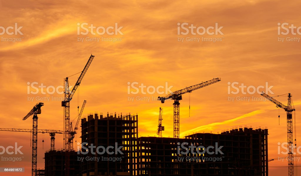 Construction site at dusk evening yellow back light, silhouette...