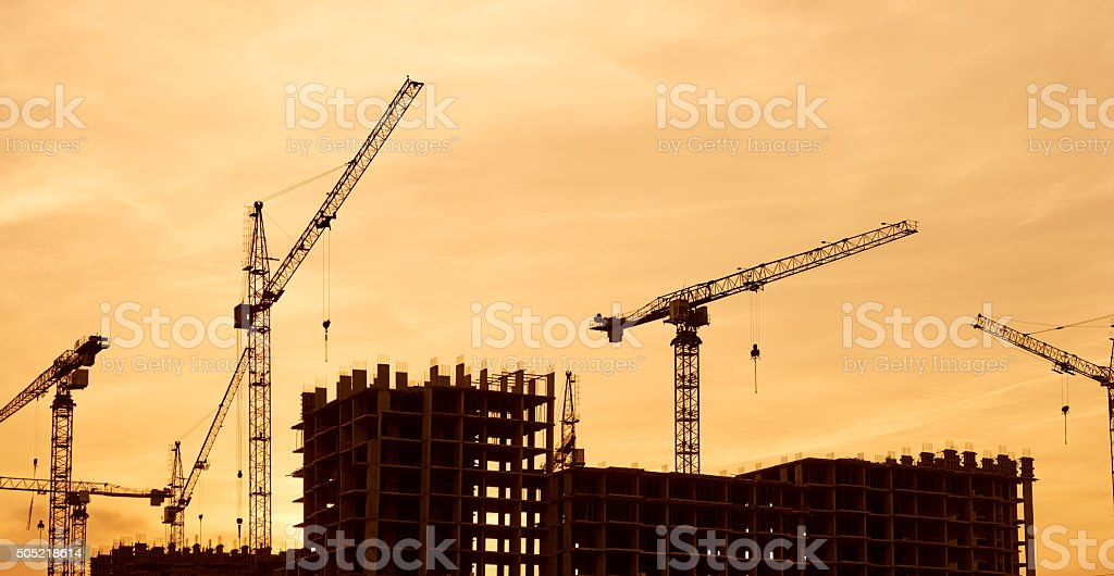 Construction site crane at dusk crane stock photo