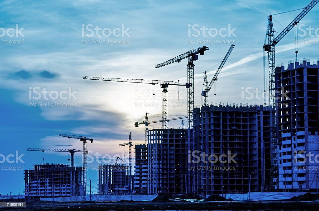 Construction site crane at dusk stock photo