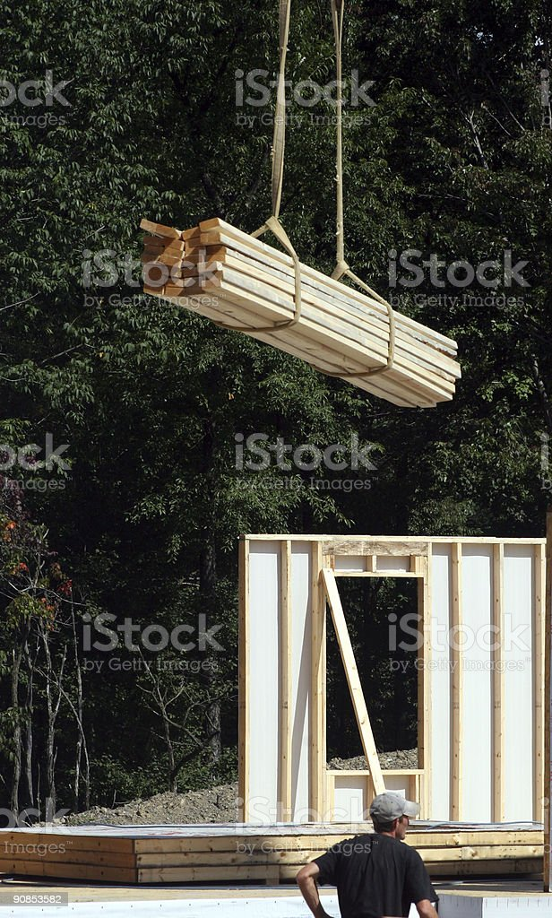 Construction Site - Crane dropping boards royalty-free stock photo