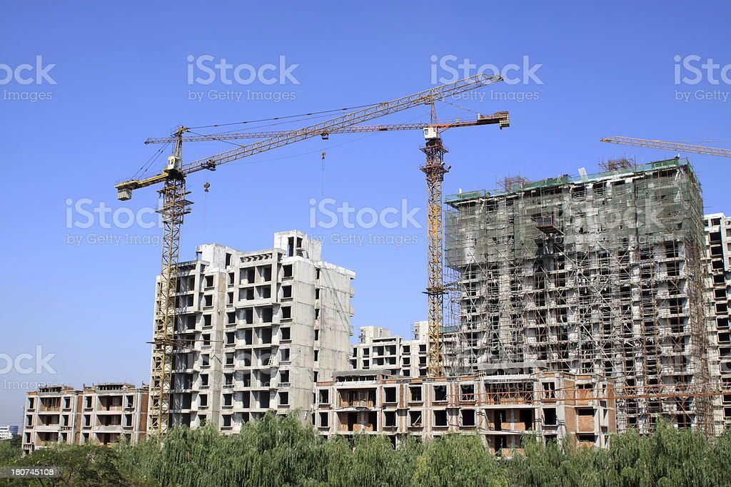 construction site crane equipment under the blue sky royalty-free stock photo
