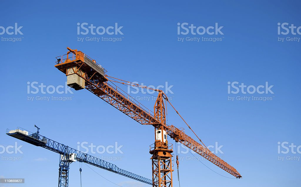 Construction Site Cranes Against a Clear Sky stock photo