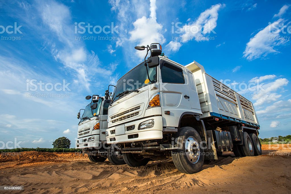 construction site digger, excavator and dumper truck. industrial stock photo