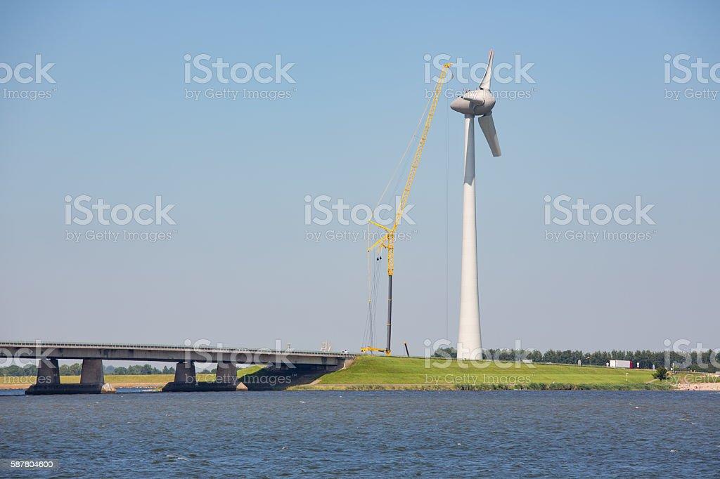 Construction site Dutch windturbine near concrete bridge stock photo