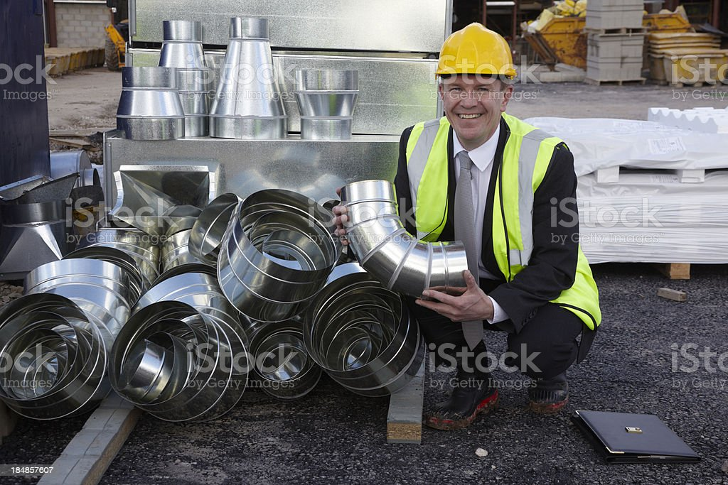 Construction Site executive with aluminium air duct stock photo