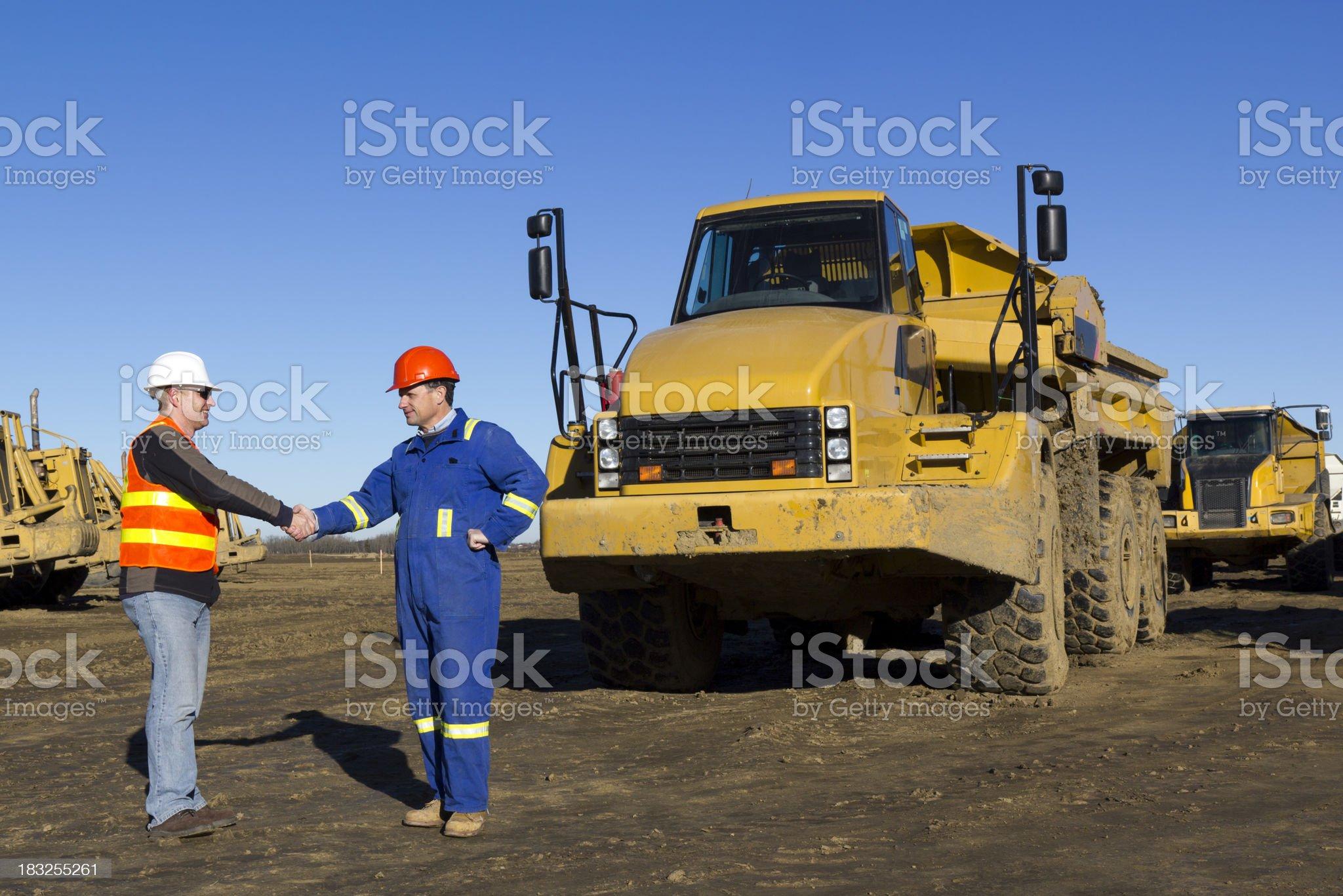 Construction Site Handshake royalty-free stock photo