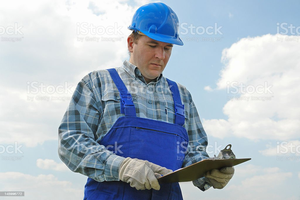 Construction site manager with notepad royalty-free stock photo