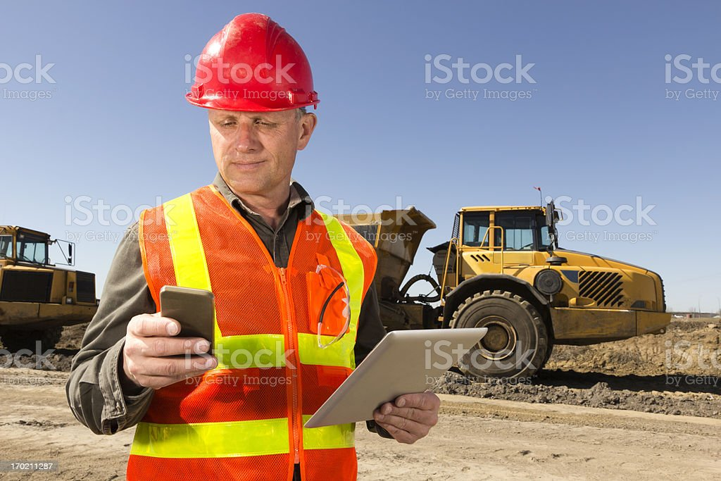 Construction Site Multitasking royalty-free stock photo