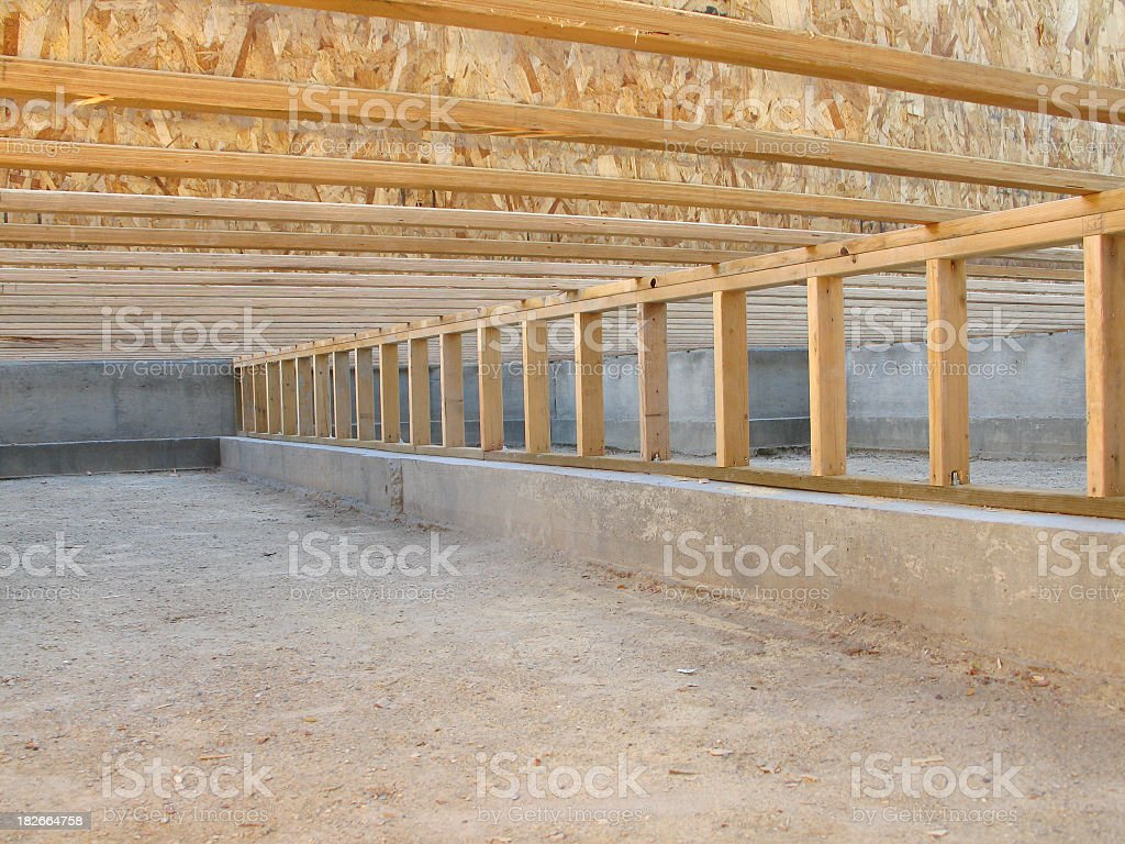 Construction Site: Neat Clean Crawlspace, Floor Joists, and Pony Wall stock photo