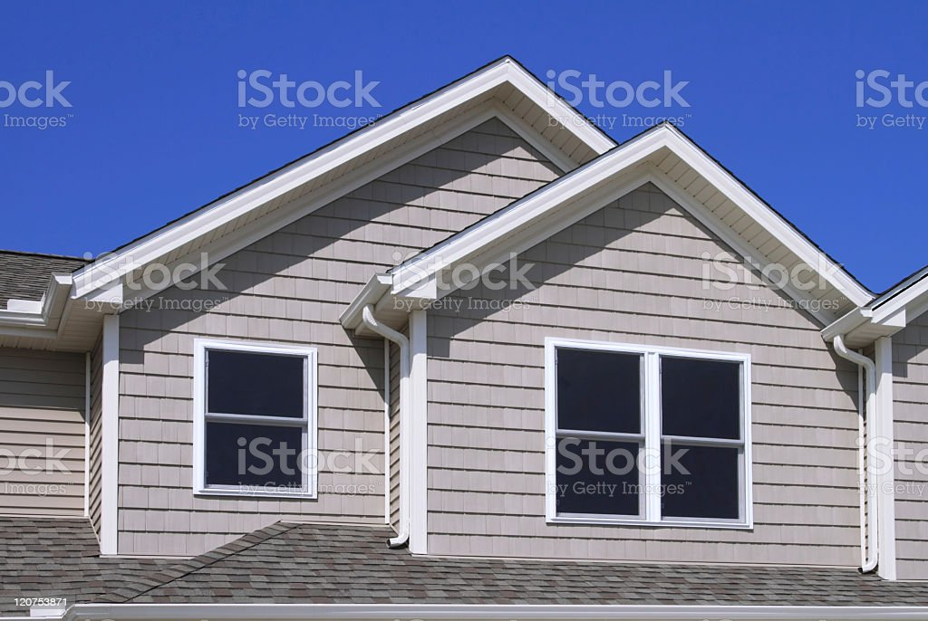Construction Site, new home showing siding, gutters and shingles royalty-free stock photo
