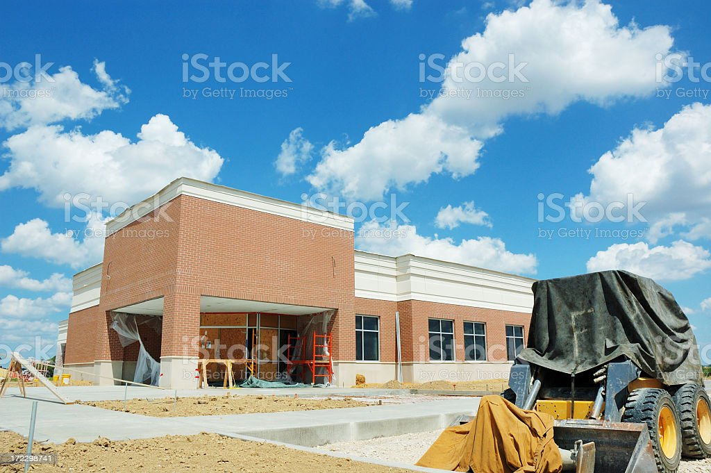 Construction site of an office building under blue skies royalty-free stock photo