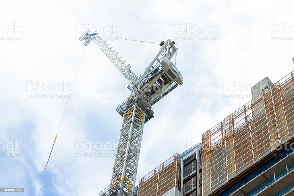 Construction site of skyscraper with tower crane, copy space stock photo