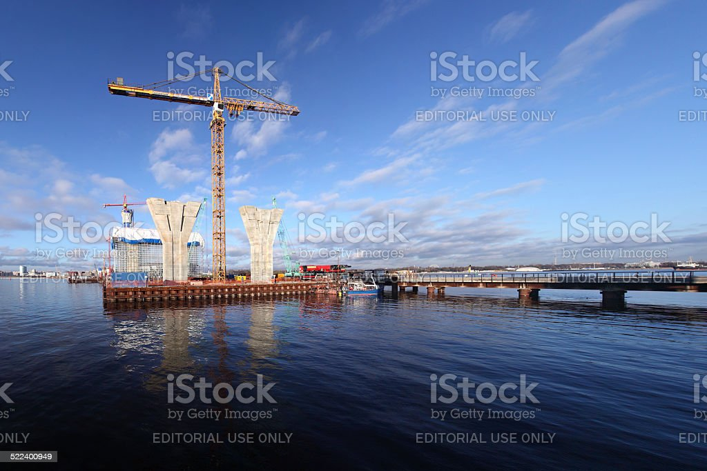 Construction site on platform surrounded by water, building Cable-stayed bridge. stock photo