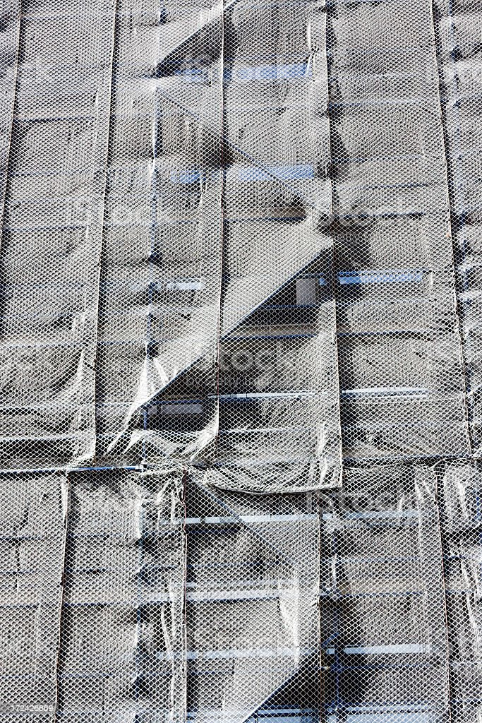 Construction site scaffolding safety net, copy space royalty-free stock photo