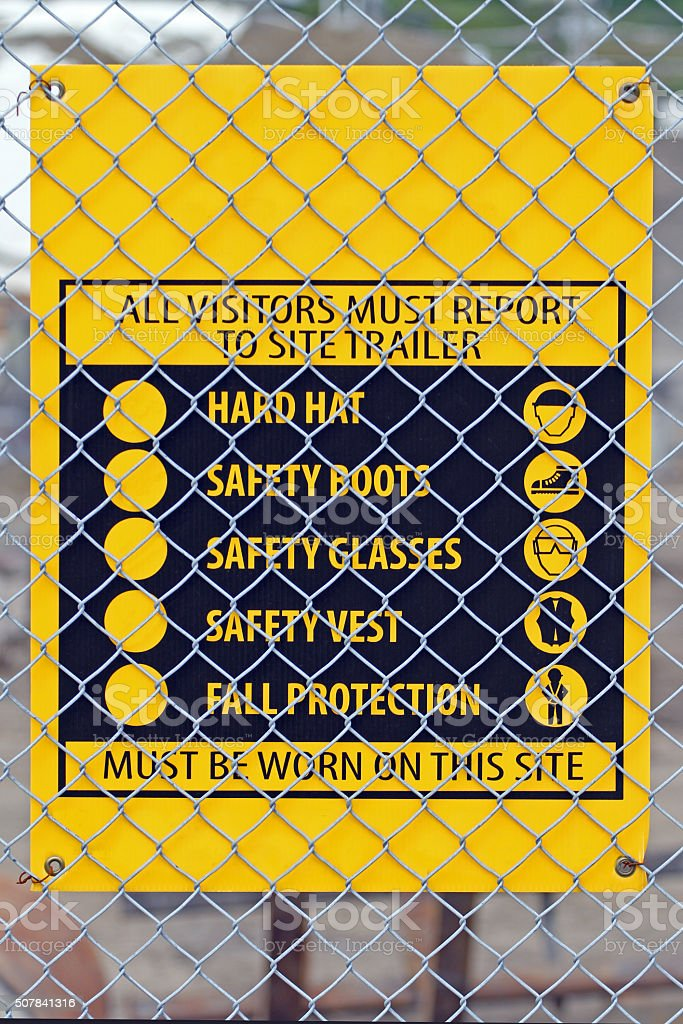 Construction Site Sign Attached To A Chainlink Fence stock photo