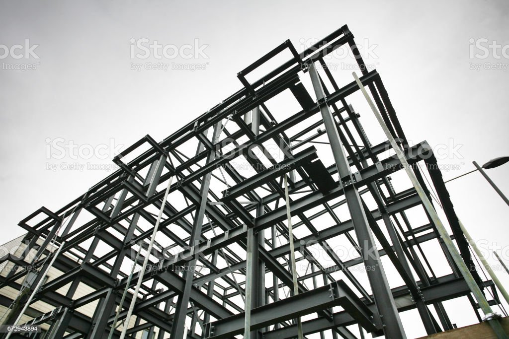 Shot of steel frame made of rsjs on a construction site in cloudy...