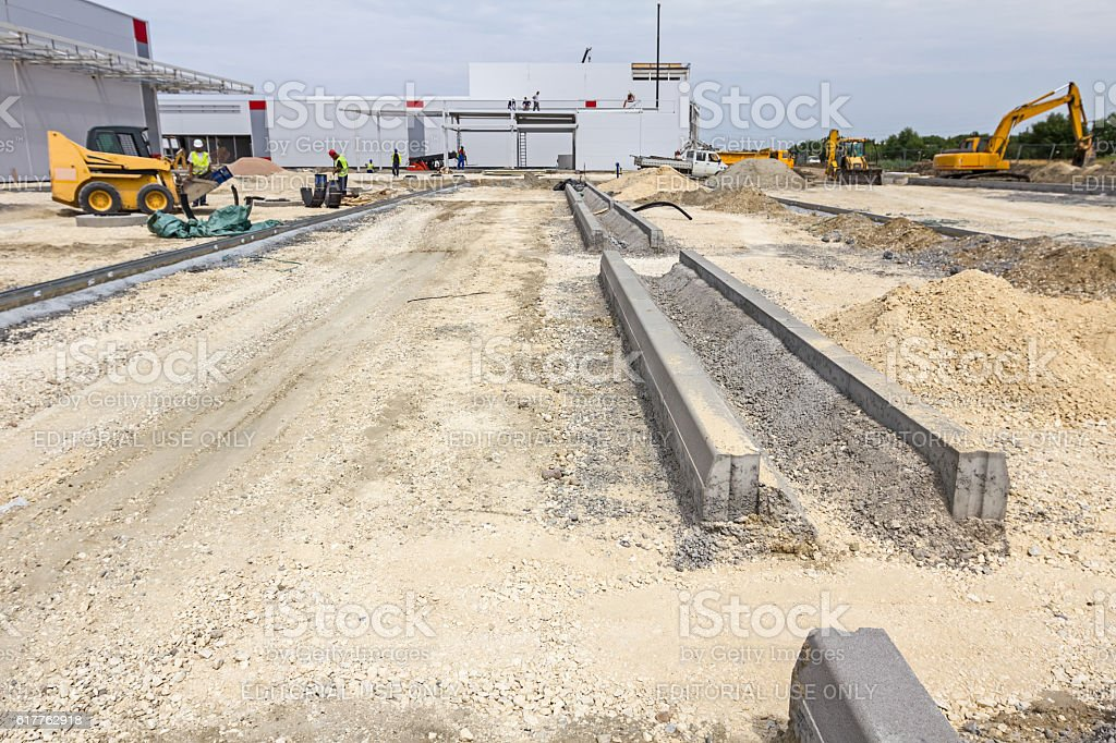 Construction site, the roadside stones placed on gravel. stock photo