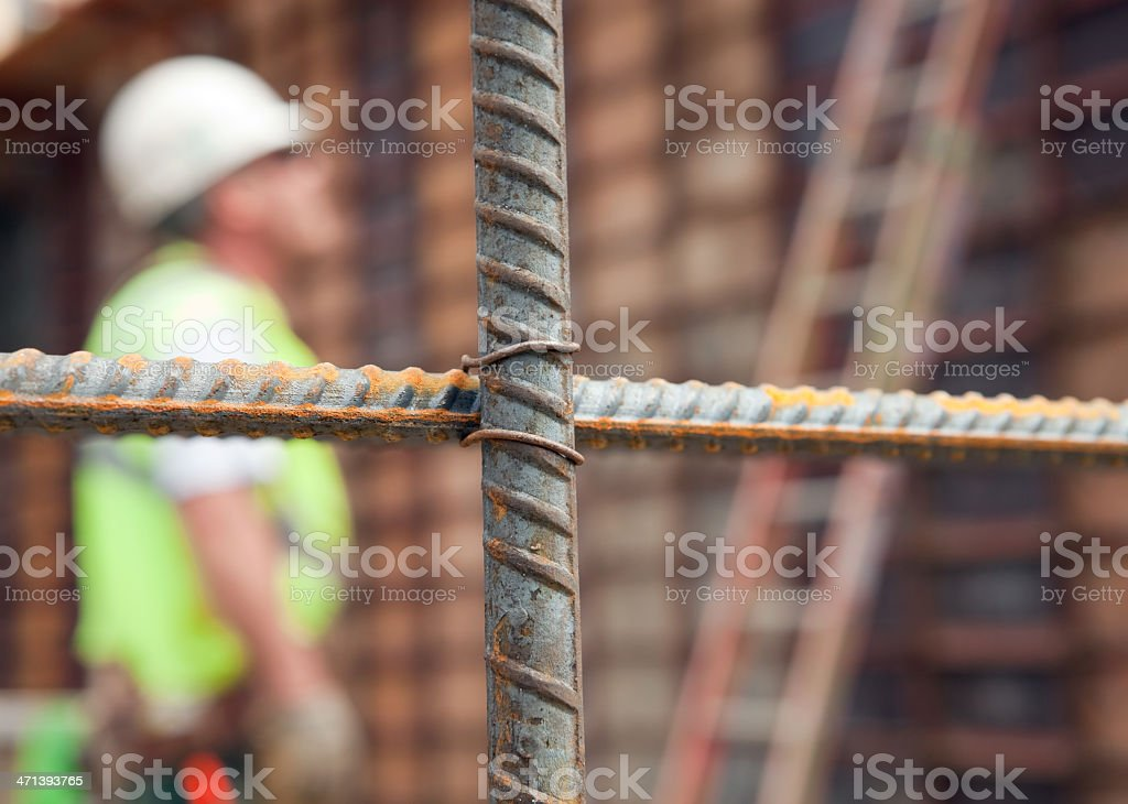 Construction Site Wall Reinforcement Bar with Blurred Worker stock photo