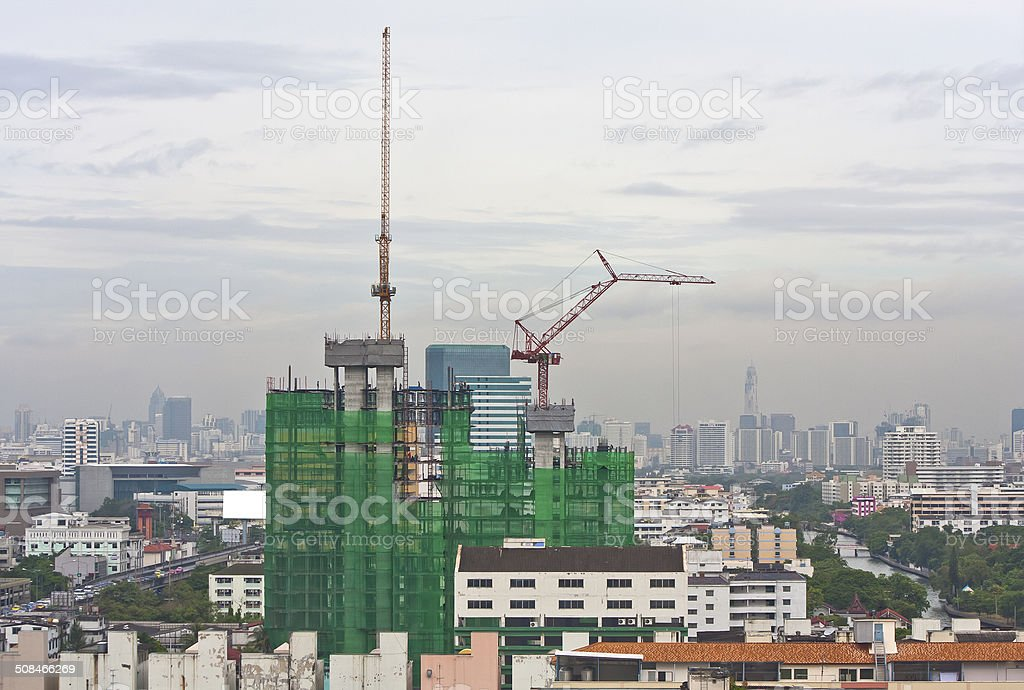 Construction site with a crane in the morning. stock photo