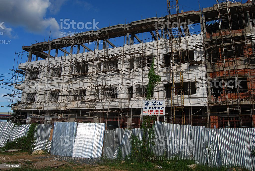 Construction Site with Bamboo Scaffolding stock photo