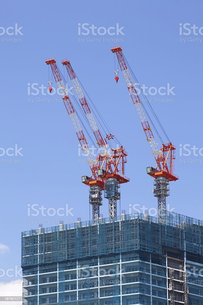 Construction site with crane over a building royalty-free stock photo