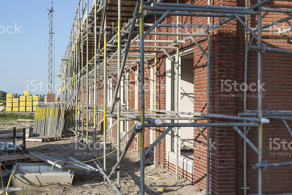 Construction site with family houses in scaffolding royalty-free stock photo